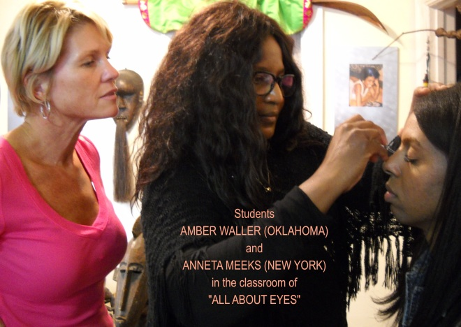 "Anneta Meeks a professional make-up artist on staff at NBC studies ""ALL ABOUT EYES"" at Petra Alexandra, Inc. while Graduate Amber Waller Looks on."